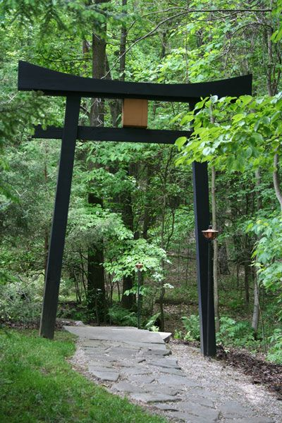 Typically I like the entrance to the woods to be unexpected or slightly more natural. but this bold entrance to a Japanese woodland garden is striking! ~cmr