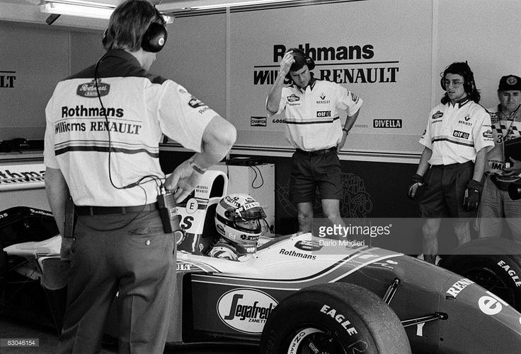 Brazilian race car driver Ayrton Senna (1960 - 1994) and the Williams F1 Racing Team crew during a qualifying session for the San Marino F1 Grand Prix on the Imola Circuit, Imola, Italy, 30th April 1994. Senna died May 1 after an accident during the race.