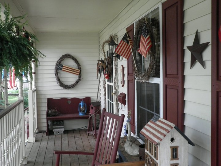My ideal porch! It fits us so well with the Americana theme! Looks like I have to get to work to recreate this look!