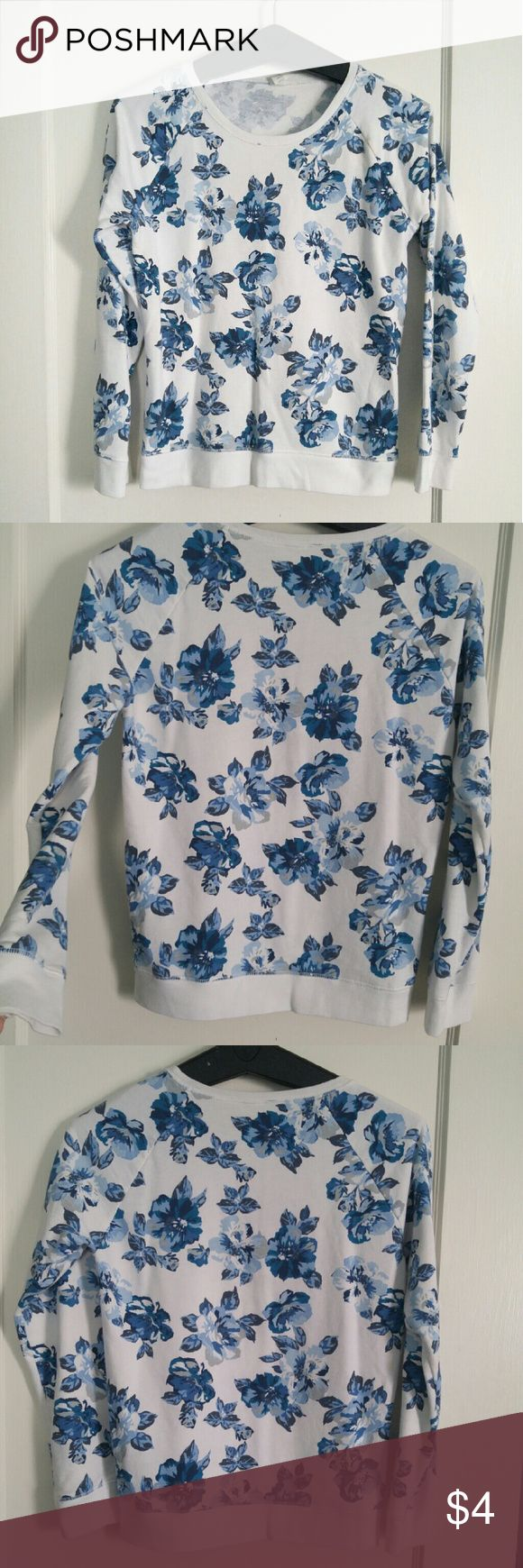 Old Navy long sleeve top. Beautiful blue and white floral sweatshirt. This is a girls XL so it fits like a women's small/ medium. Great lightweight terrycloth material to throw on after a workout, to hangout in, or for bedtime. In great shape and versatile. Comfortable and cute. Old Navy Tops Sweatshirts & Hoodies