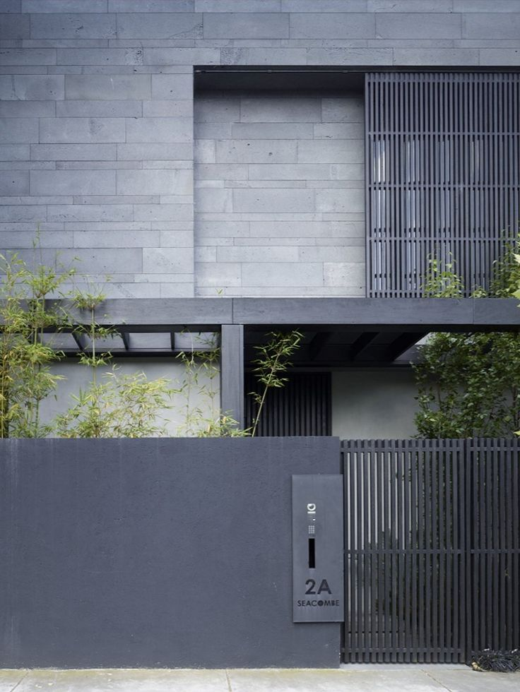 "Seacombe Grove House by b.e architecture. ""The bluestone cladding is cut in 4 differing widths and a random stacked pattern is utilized to accentuate the horizontality of the building, while the black charred timber screens and fences contrast the stone in their vertical arrangement. The bluestone is employed as an antidote to the prevalence of acrylic render and its flat plasticity and immediacy"""