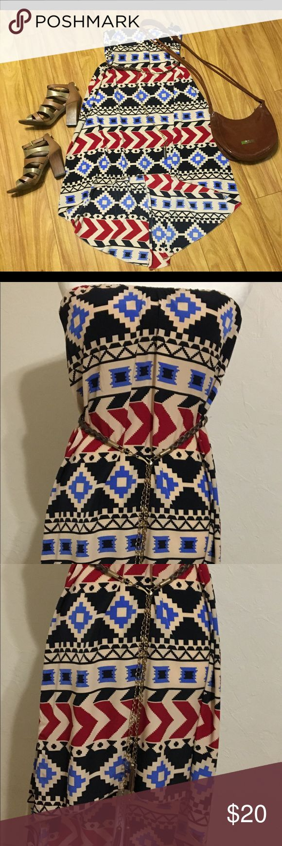 Lette Aztec Strapless Dress w Tassel Belt Size L NWOT Discover your bohemian side with this beautiful hi-low dress. Adorned with braided leather belt with chain and tassels it could be worn around town, to the music festival or on a hot summer day around town. Can be worn with or without the belt. Sleeveless dress has a built in layer on the front and bra paddings. Really nice tan color with bright prints. Lette Dresses High Low