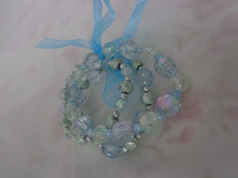 Acrylic bracelet, 7.5 inches  colors: grey, aqua blue & hot pink