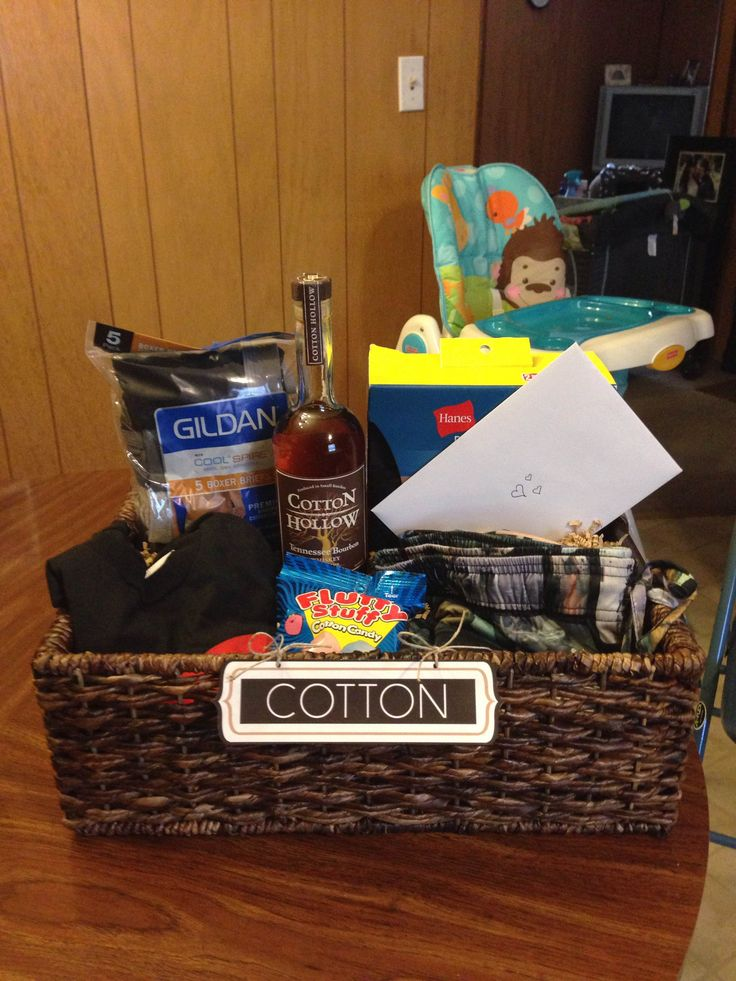 """Cotton"" gift basket I put together for my husband for our second wedding anniversary. Gifts: Hanes Cotton X-temp crew shirts - Cotton cool spire boxer briefs - Cotton Star Wars PJ pants - Cotton DeadPool shirt - Cotton Hollow Tennessee Bourbon - Fluffy Stuff cotton candy. #secondanniversary #anniversarygifts #cottonanniversary #weddinganniversarygifts"