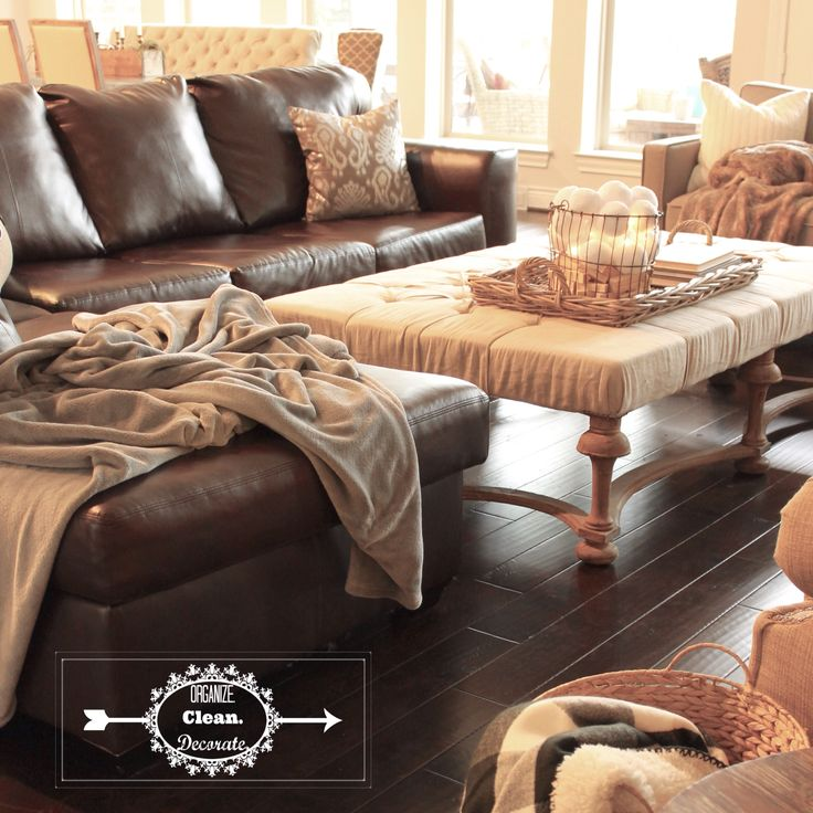 Neutral living room with brown grey gray cream beige linen tufted ottoman leather sectional black and white natural elements cozy warm from http://organizecleandecorate.com/