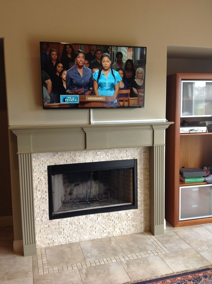 Tv Mounting Over A Fireplace With Wires Concealed In Wire