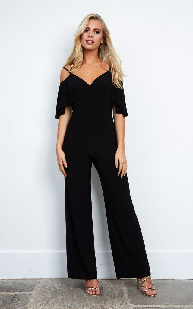 Every wardrobe needs a little black jumpsuit! Featuring a wrap front double strap with waistband and short sleeves. Perfect to dress up or down.