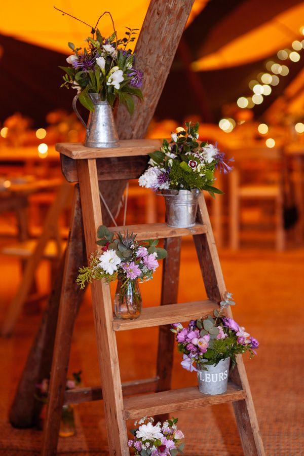 Festival Camp Meadow Tipi Wedding Ladder Flowers http://toastofleeds.com/
