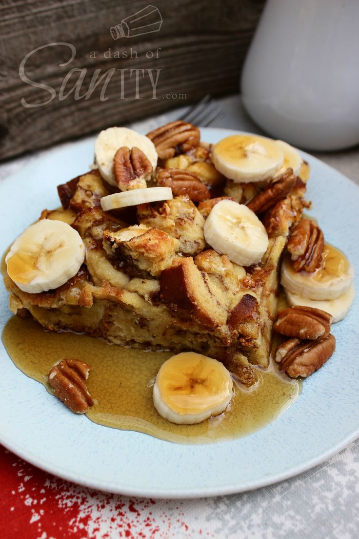 Banana Foster Baked French Toast - A Dash of Sanity | Going to trade in bourbon for the rum, almond milk for regular milk, and reduce the maple syrup.
