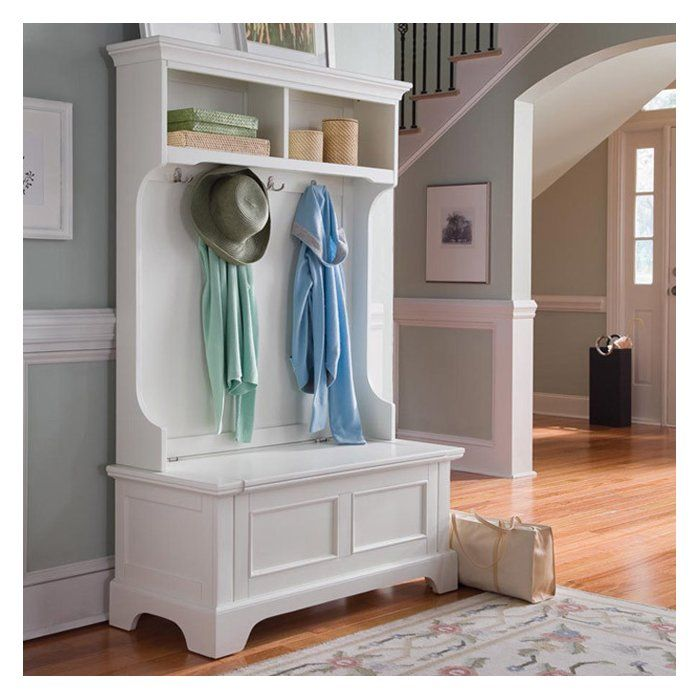 Bring order to any busy mudroom or entryway with this chic hall tree, showcasing 4 double hooks, 2 cubbies, and a convenient storage bench.