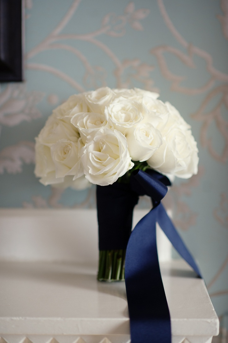 White roses and navy ribbon. Photography by Robert & Kathleen Photographers.
