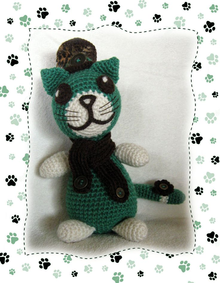 Crochet cat I've designed with a cute little hat with a feather