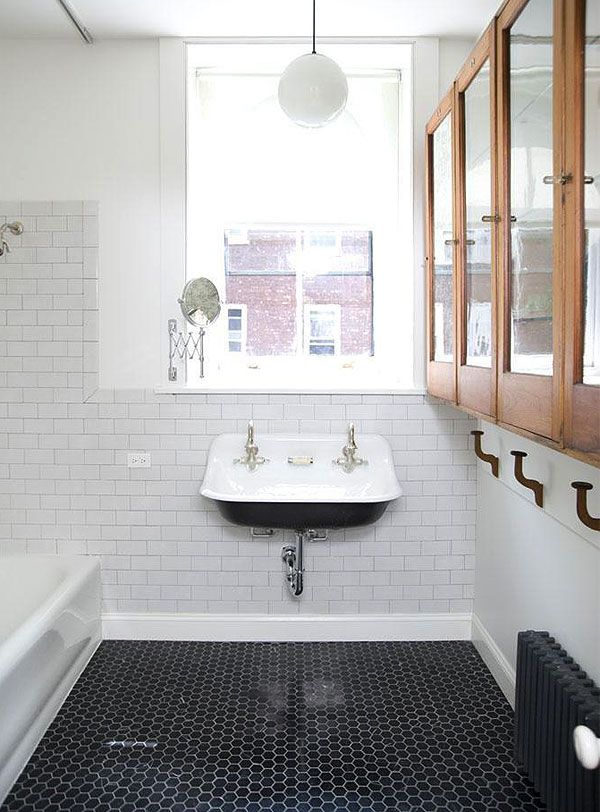 Subway tiles, black hex floor tiles, wooden cabinets and incredible sink... dream bathroom !