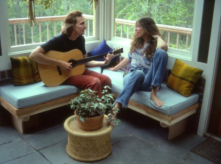 carly simon and james taylor by the window at martha's vineyard.