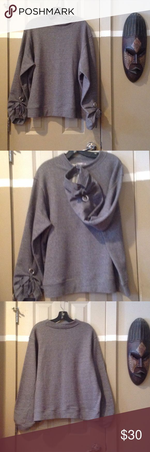 ZARA SWEATSHIRT WITH FANCY BOW TIE ARM CLOSURE ZARA SWEATSHIRT WITH FANCY BOW TIE ARM CLOSURE. Large and great quality. NWOT/never worn. Fits like a large, but can fit a small extra large. Zara Tops Sweatshirts & Hoodies