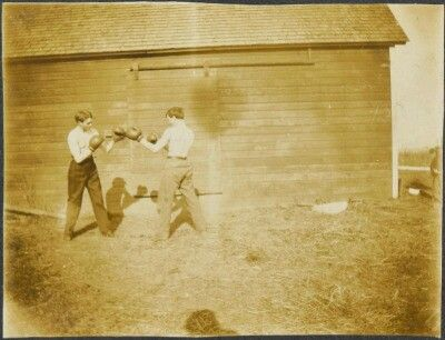 Boys boxing by the Barn