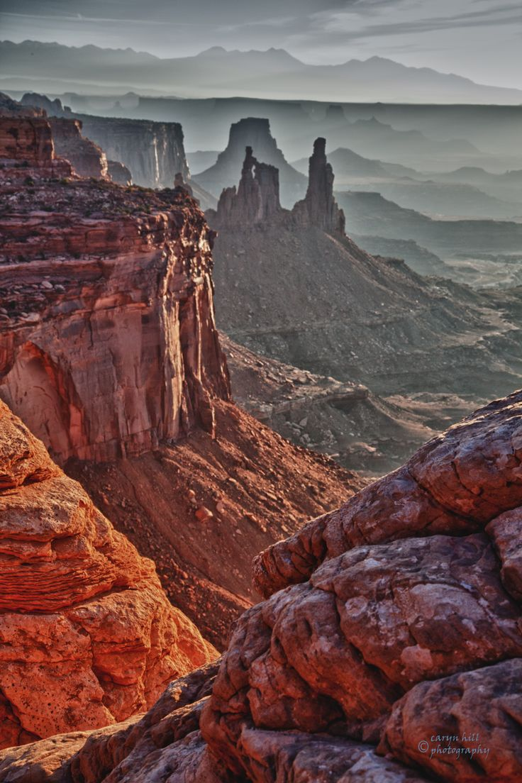 """""""Washing Woman"""" as seen from the south side of Mesa Arch.  www.carynhillphotography.com TRAVEL ARIZONA BY  MultiCityWorldTravel.Com For Hotels-Flights Bookings Globally Save Up To 80% On Travel Cost Easily find the best price and ..."""