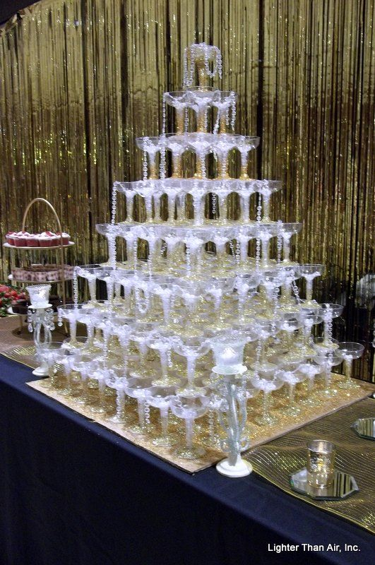 Great Gatsby theme: champagne glasses pyramid, with cascading pearls!