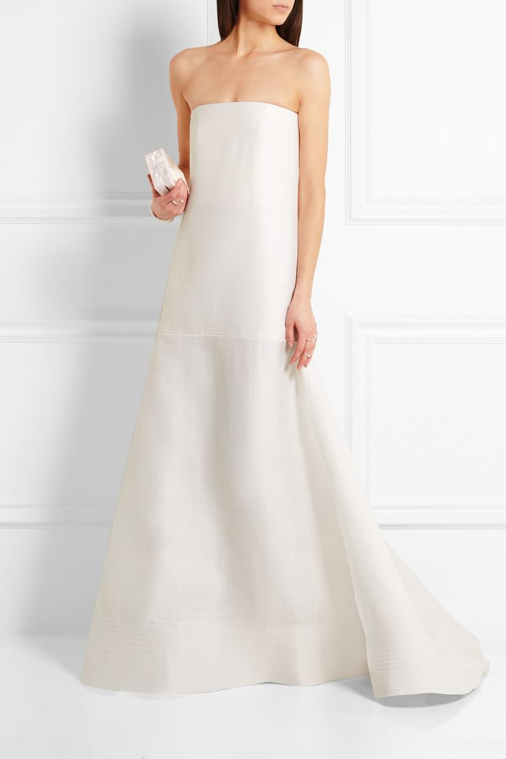 Crafted from a textured blend of wool and silk, Roksanda's 'Maury' gown is a chic choice for contemporary brides. Cut for a flattering A-line silhouette, this ivory piece has a boned bodice for structure and a voluminous skirt finished with elegant horizontal stitching. Complete your look with metallic accessories.  Shown here with: Edie Parker Clutch, Gianvito Rossi Sandals, Cornelia Webb Rings, Maison Margiela Cuff, Maison Margiela Ring.