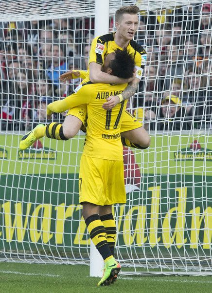 Dortmund's Gabonese forward Pierre-Emerick Aubameyang celebrates with Dortmund's forward Marco Reus after Aubameyang scored the first German division Bundesliga football match between SC Freiburg and Borussia Dortmund in Freiburg, southwestern Germany, on February 25, 2017. / AFP / THOMAS KIENZLE / RESTRICTIONS: DURING MATCH TIME: DFL RULES TO LIMIT THE ONLINE USAGE TO 15 PICTURES PER MATCH AND FORBID IMAGE SEQUENCES TO SIMULATE VIDEO. == RESTRICTED TO EDITORIAL USE == FOR FURTHER QUERIES…