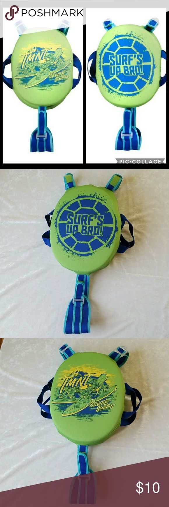 """Nickelodeon Kids TMNT Progressive Swim Pad Trainer Nickelodeon Kid's (boy) Teenage Mutant Ninja Turtles Progressive Swim Pad Trainer (good for 40-55 lbs. kid)  Product Dimension: 9.7"""" x 8.0 x 2.5"""" Child weight min.: 40 lbs. Child weight max.: 55 lbs. Material: 100% polyester --->adjustable velcroo straps ( 5th and 6th photos) --->removable pads ---> in great used condition. Feel free to ask. Nickelodeon Swim"""