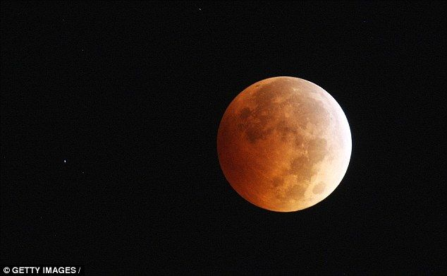 Blood moons - an image from the last event is shown- are predicted in the Bible. According to the King James Bible: 'The sun shall be turned into darkness, and the moon into blood, before the great and the terrible day of the Lord comes'