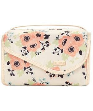 Flower Beauty In Bloom Roll Up Valet | Get the most bang for your buck with this cube case. It includes four large plastic compartments—read: no spills!—that zip shut and fit together to create a nice square pouch that velcros shut. The cute, whimsy floral print keeps it looking very ladylike, too.