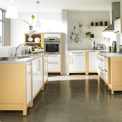 Free standing units from Ikea:  I really like the idea of a free standing kitchen--more flexible and you can clean under them!