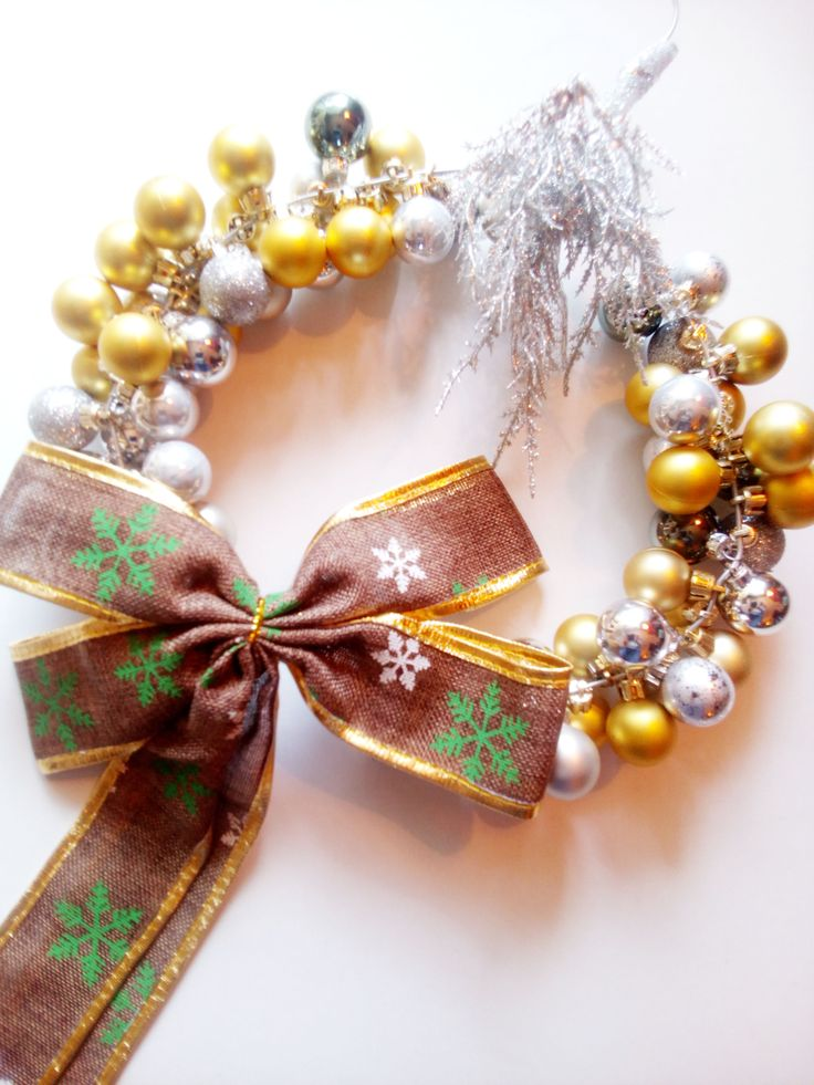 handmade christmas wreath with silver and golden balls by mademeathens