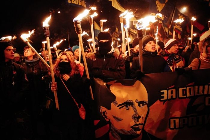 In Kiev, supporters of the Ukrainian nationalist parties Svoboda and Right Sector carry torches during a march to mark the 106th anniversary of Stepan Bandera's birth. Bandera was a Ukrainian politician and one of the leaders of the country's nationalist movement