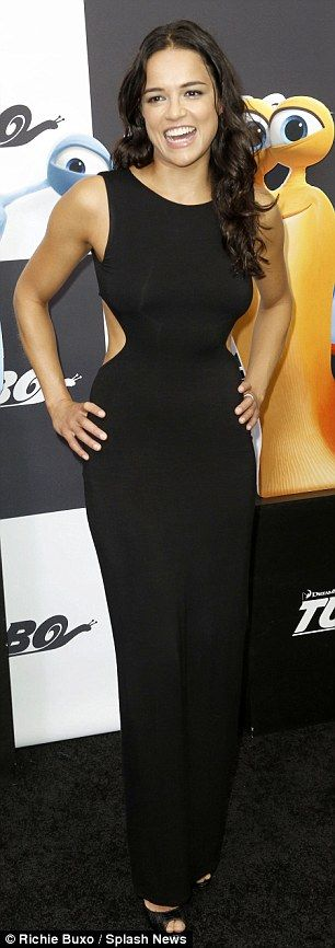 Looking good: Michelle Rodriguez, who also voices a character in the film, showed off her curves in a tight black dress that featured cutouts on the waist
