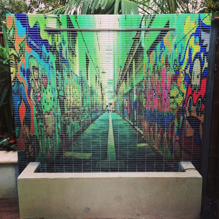 This Melbourne lane way graffiti image was turned into a mosaic tile bringing this water feature to life