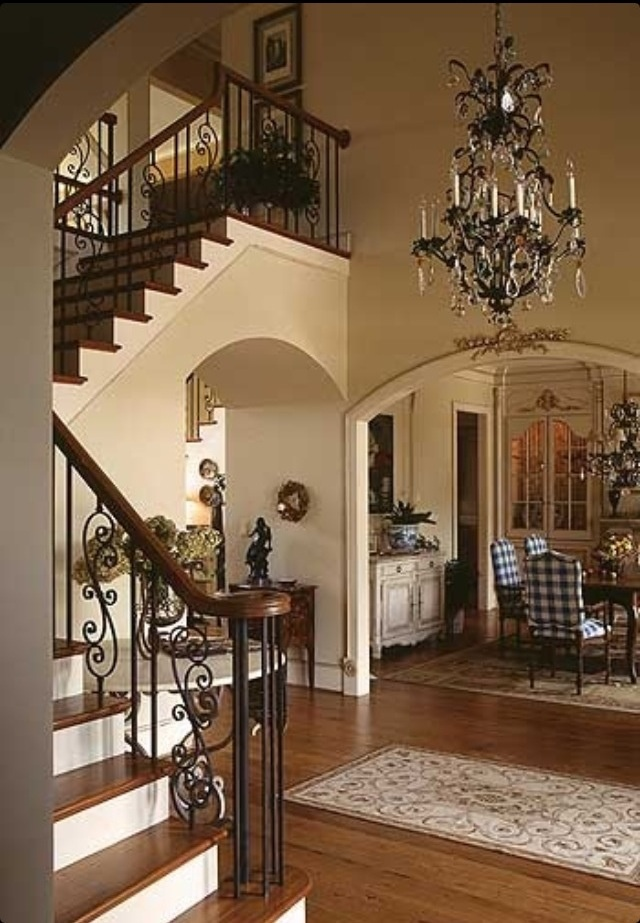 Love the stair rail design And entry
