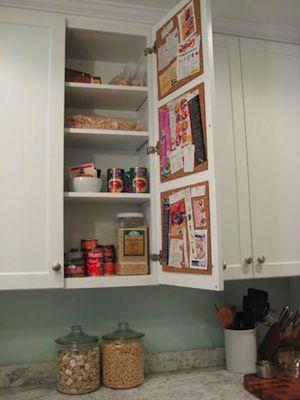 Create a Hidden Cork Board Message Center on the Inside of a Kitchen Cabinet