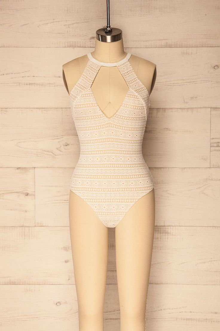 Therma #Boutique1861/ Swim and suntan in style with this lovely, lacey swimsuit! The deep V neck and open back will show you off as you soak up the sun. The stretch beige lining keeps you covered while the cut-out lace gives a pastoral quality to the otherwise modern style. Wear it as a bodysuit with pants or a maxi skirt to bring a little summer romance to your outfit!