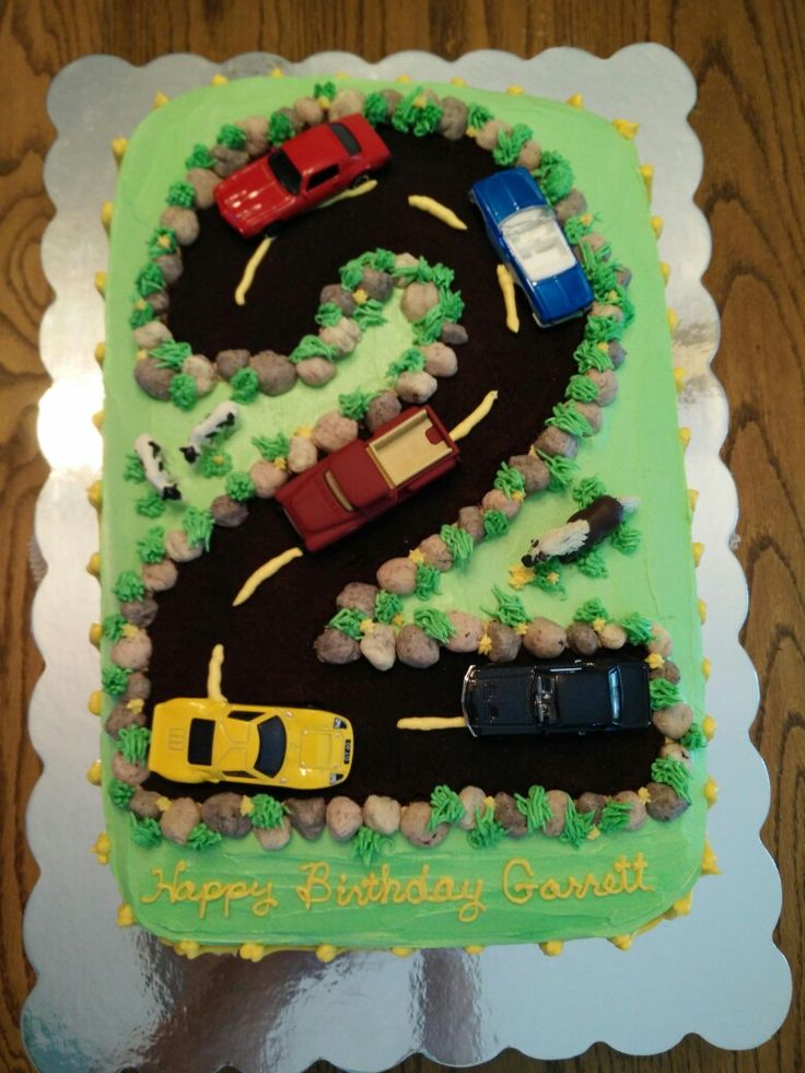 Cake i made for a friends little boy. I used fine Oreo crumbs for road. Used homemade candy rocks. No directing. Picture only