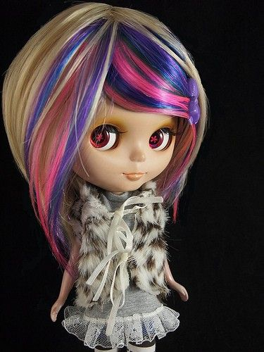 Custom wig for Blythe on Etsy. So it's not real hair, but blonde with those funky highlights.