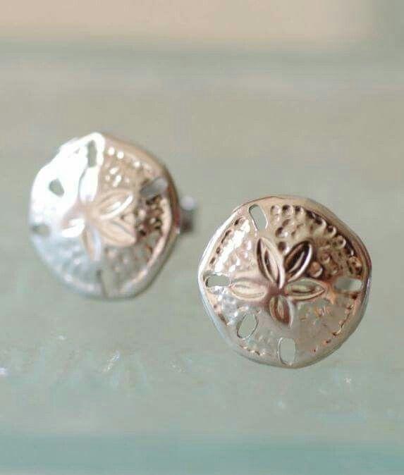 Cute stud earrings...mini sand dollars from By The Seashore...via Completely Coastal