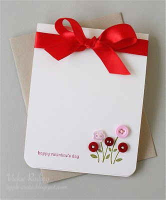Sweet and simple handmade valentine's card with buttons and a simple bow.