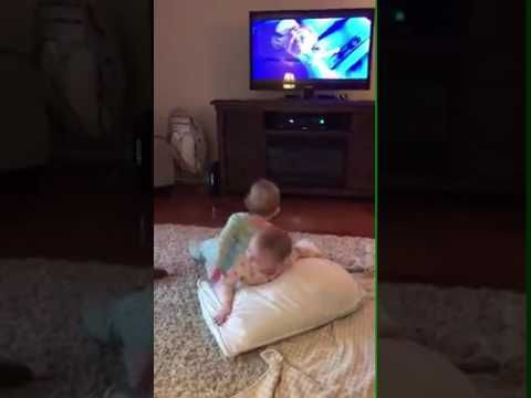 Babies twins act their favorite scene from the movie Frozen Disney