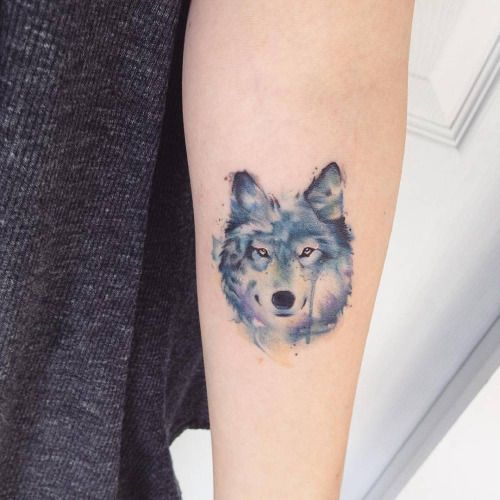 Watercolor style wolf tattoo on the left forearm. Tattoo artist:...