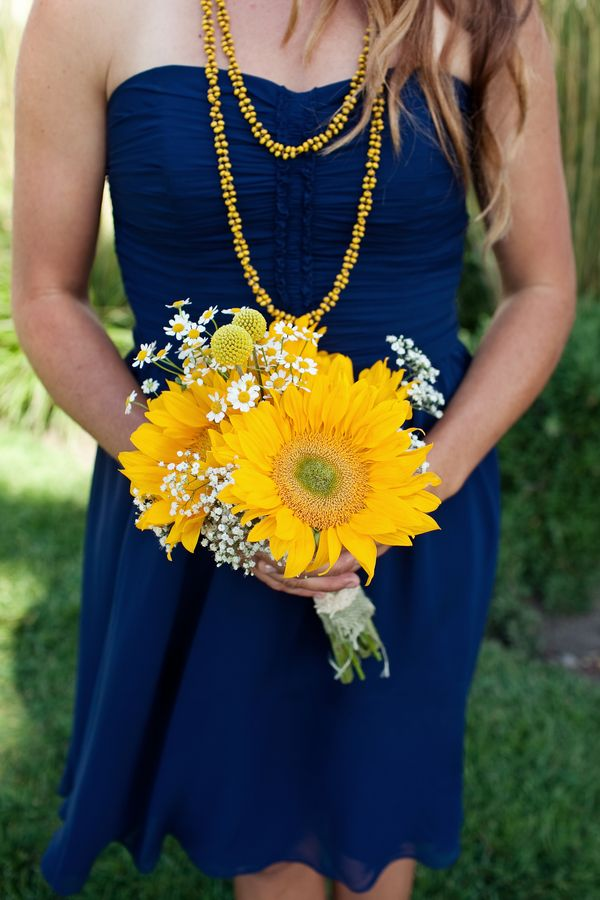 This wedding has some cute ideas! I don't think I would do a whole vintage school theme, but it is adorable! I love the blue bridesmaid dresses with yellow flowers.