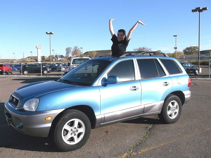 Sarah and John's new 2004 HYUNDAI SANTA FE! Congratulations and best wishes from Grand West Kia and SABRA WHITE.