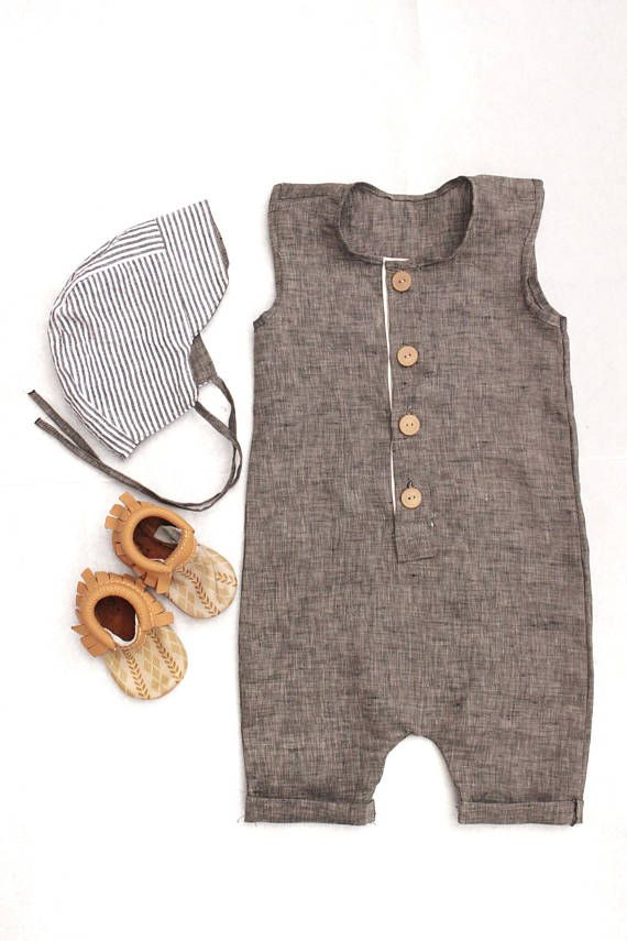 This sleeveless, button-up romper is perfect summer wear for you baby boy or toddler. This soft linen material will move just as freely and quickly as you little one does! Complete the outfit with our seersucker bonnet to add a touch of vintage to the trendy look. Buttons for easy on and off and smooth diaper changes. Whether scooting, crawling, or walking this one-piece outfit will move with your little boy and stay in place. Please note that items are handmade so pattern placement may…