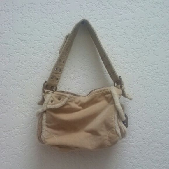 """Gap Beige Suede Faux Fur Trim Bag This Gap bag is almost vintage (15 years old) and in perfect condition--never used! Beige/tan in color with suede-like material and faux fur trim. Details include adjustable belt handle and large (plastic) hook buttons. Inside is lined with a cute contrasting pink print fabric. Dimensions are 12"""" x 8"""" x 4"""". Please ask any and all questions before purchasing. Thanks! GAP Bags"""