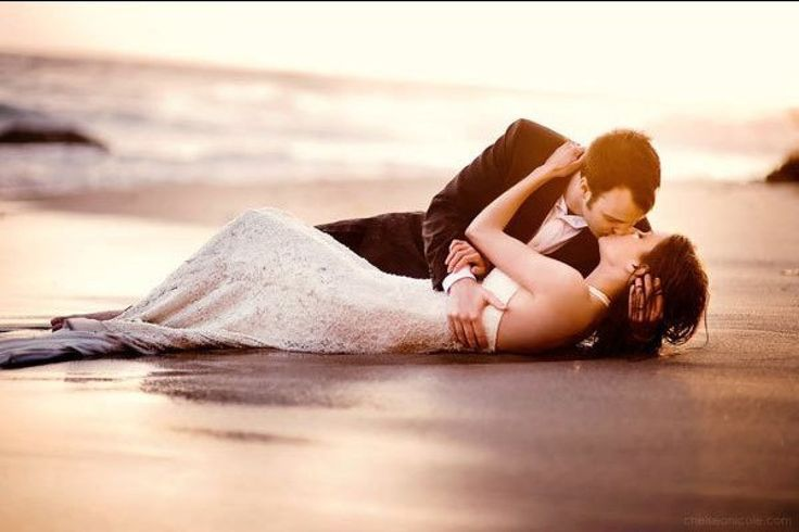 Take advantage of the romantic beach setting and grab a kiss in the sand! | Chelsea Nicole Photography