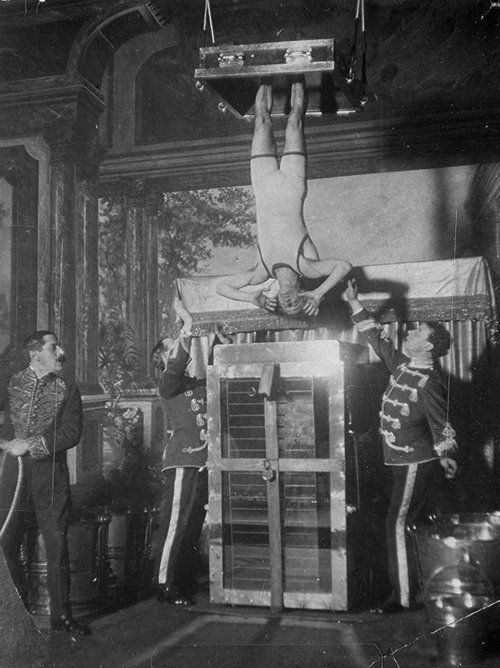 Houdini performing the Chinese Water Torture Cell, 1910s-1920s.