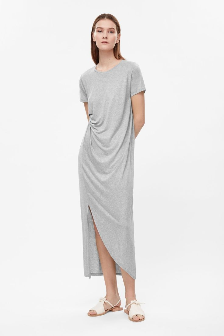 A relaxed fit, this long dress is made from a soft jersey with a melange finish. Designed with a drape at the front, it has neat short sleeves, a round neckline and a slit.
