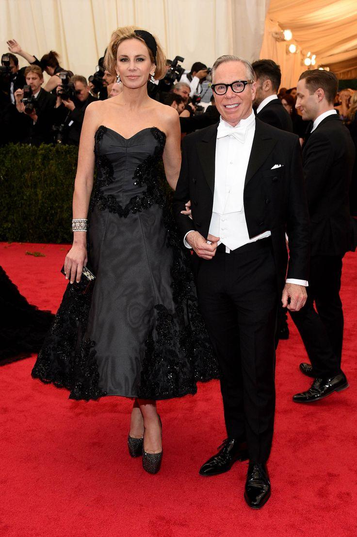 Dee Hilfiger wearing a black organza strapless evening dress by Tommy Hilfiger and Tommy Hilfiger wearing a Tommy Hilfiger Tailored custom tuxedo at the Met Gala 2014
