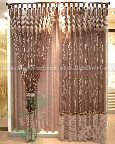 Shear curtains layered over solid. This gives the window a nice look, while keeping the sun out.